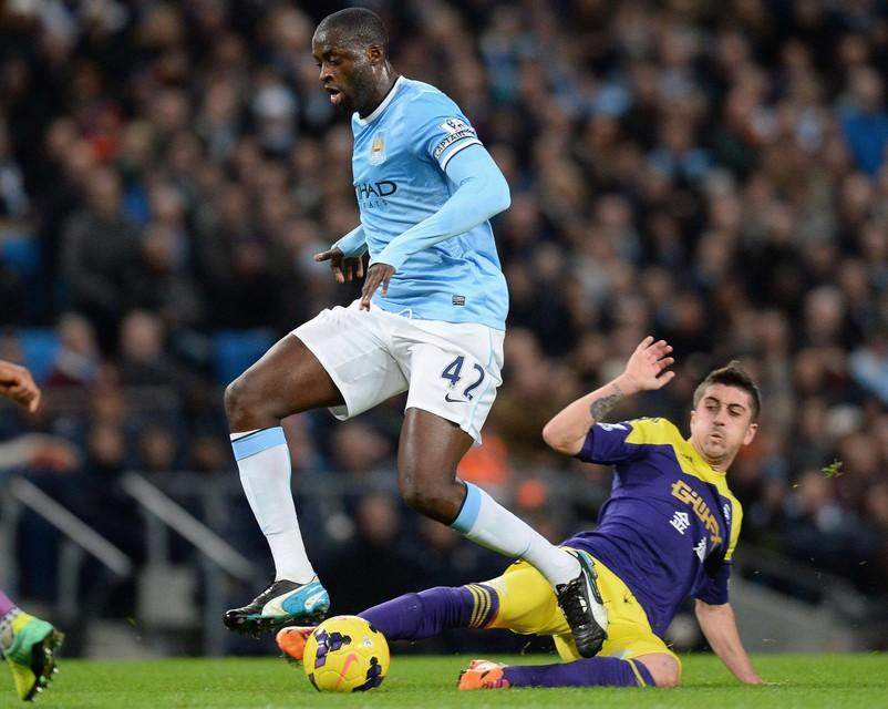 Touré in actie voor Man City.