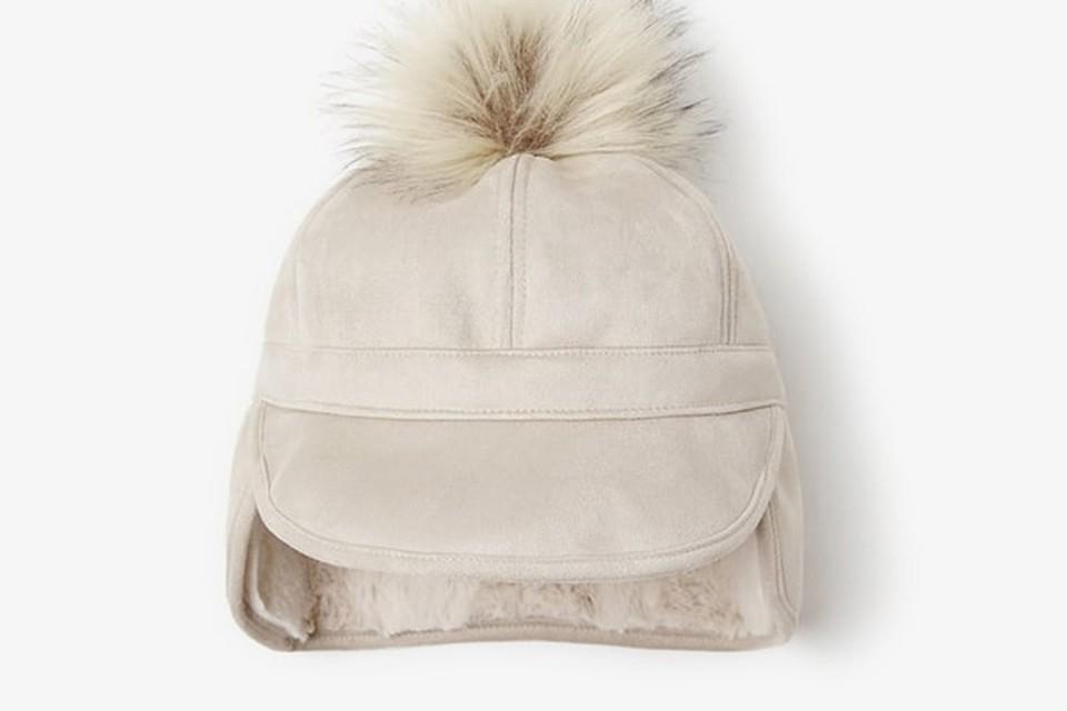 <P>Muts met pompon - Zara - 14,95 euro - www.zara.com</P>